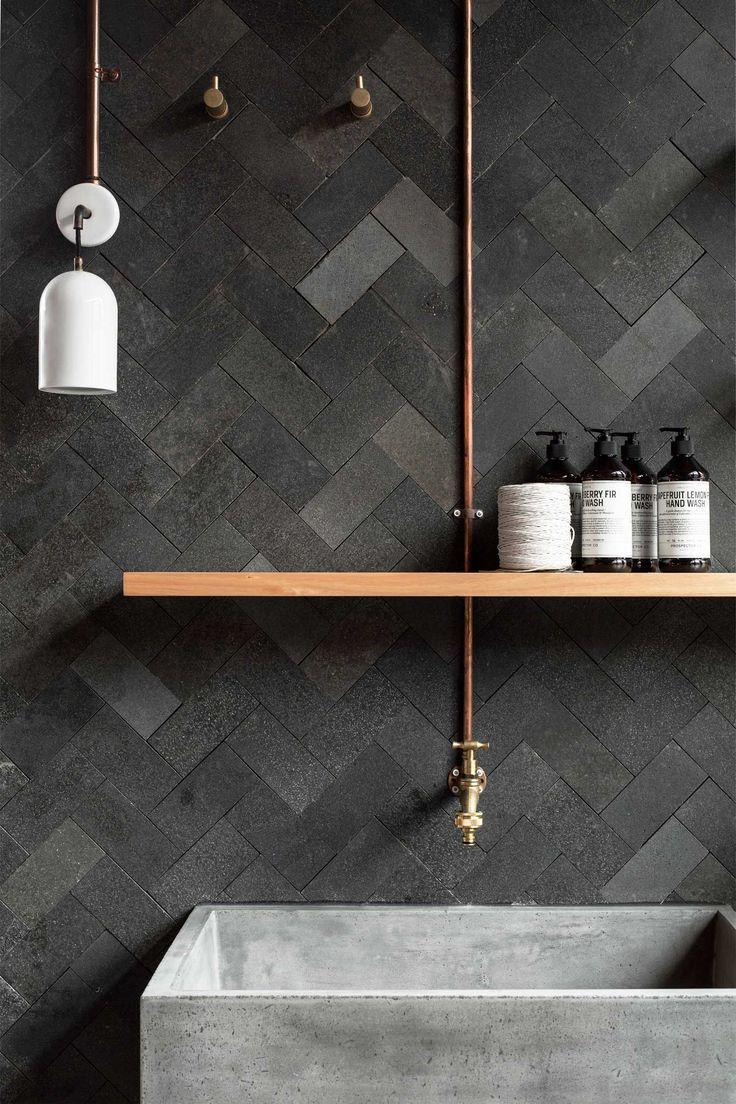 Rough finish herringbone tiles and deep concrete bathroom sink. Ramped up textures! Interview: Studio Pipkorn & Kilpatrick.