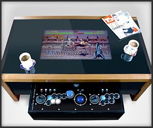 A highly customizable wooden arcade table. It has a 26″ LCD, Sanwa joysticks and buttons, a trackball, DVD-drive, Wi-Fi support, HDMI and USB ports and comes with lots of old arcade games.