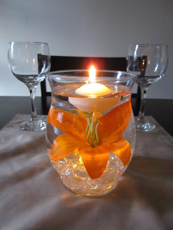 Hurricane vase floating candle centerpiece by