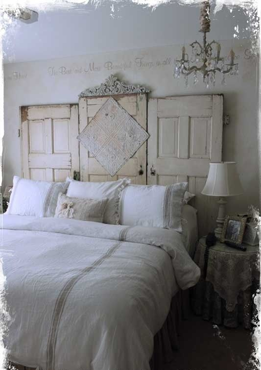 Unique headboard using three antique doors and some ceiling tin