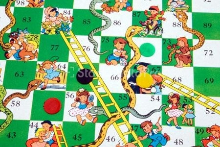 Snakes and Ladders board game 1960s. On mine the registration was terrible - eyes and mouths of children migrating to the right