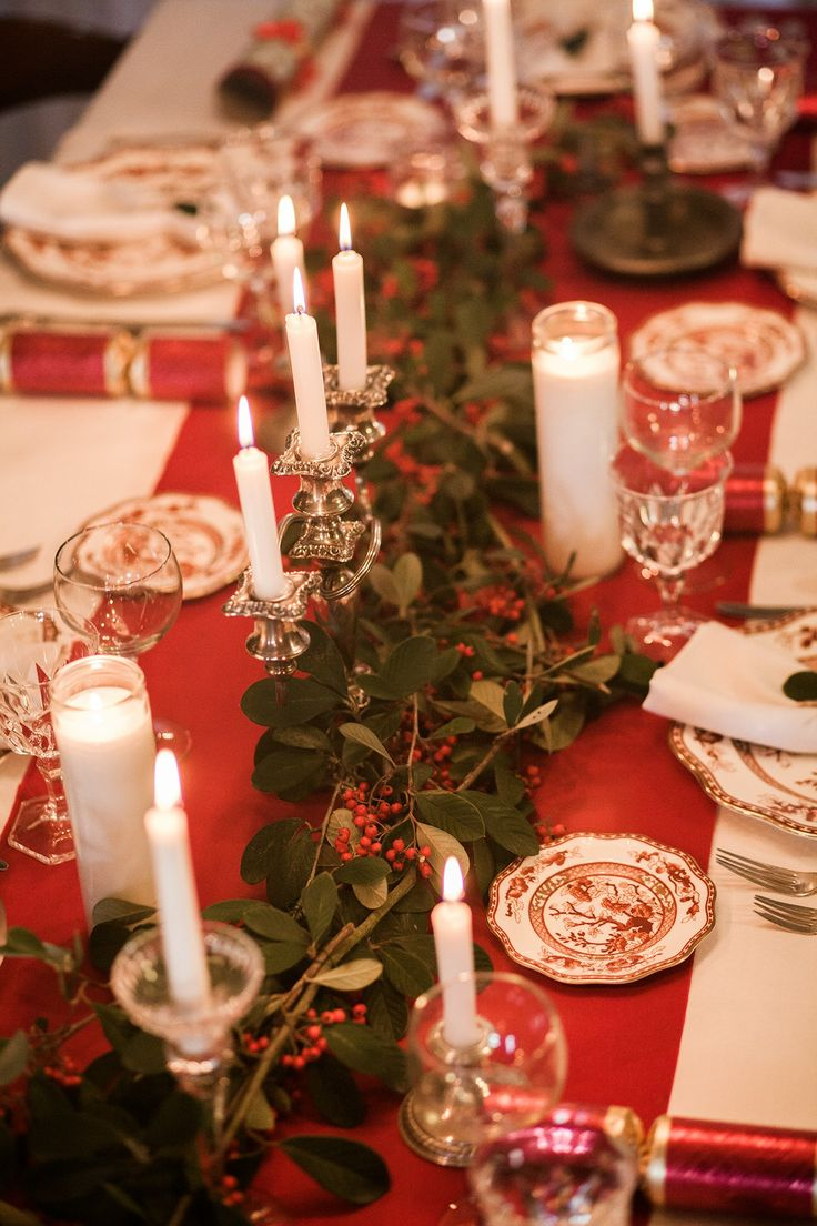 Christmas table decor with handmade red berry branch runner and candles in heirloom candelabras and candlesticks. See the post at http://tulleandtwine.com/2014/1/2/christmas-table