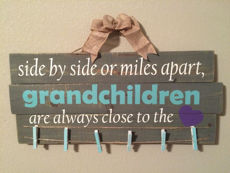 Side by side or miles apart, grandchildren are always close to the heart. Picture holder made from picket sign.