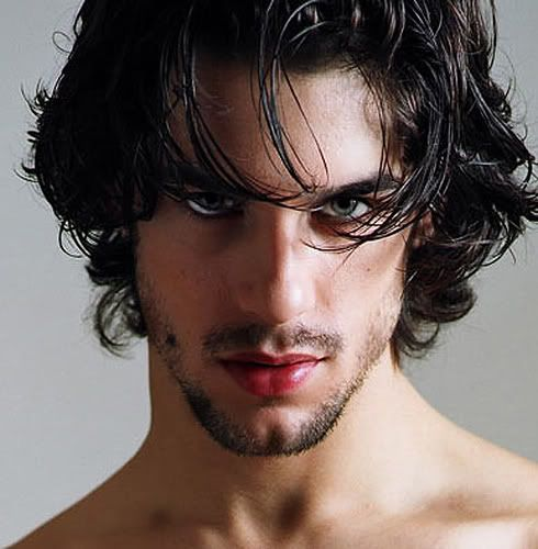 Guy With Black Hair And Green Eyes Photo