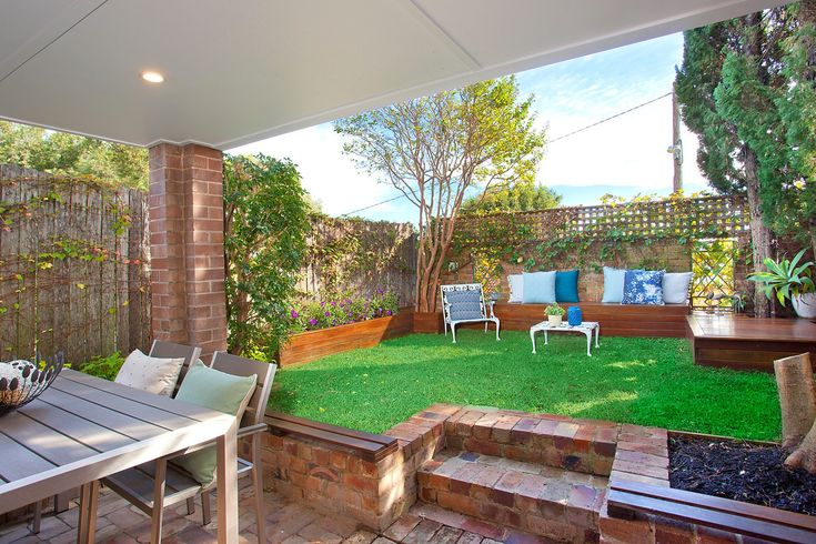 Private rear garden, built-in seating, throw cushions, outdoor table & chair, lattice, undercover entertaining area, Pilcher Residential