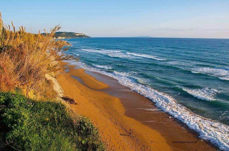 Agios Georgios beach. Photo by: Doukakis Basilis #GreenCorfu - greencorfu.com - https://pinterest.com/greencorfu/