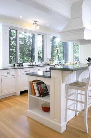 Kitchen breakfast bar...woodwork details are lovely, love the corbels