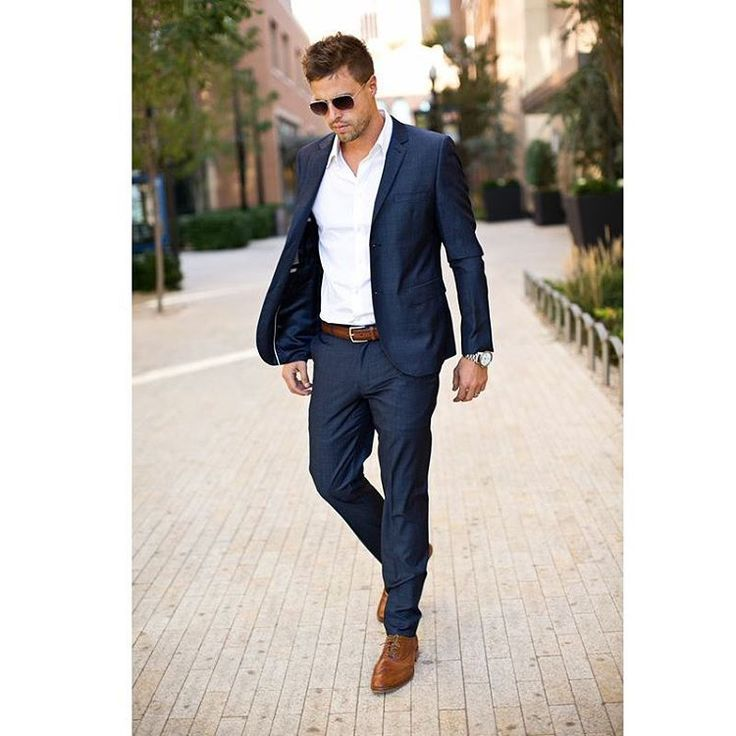 dark blue suit, white shirt, brown shoes and belt
