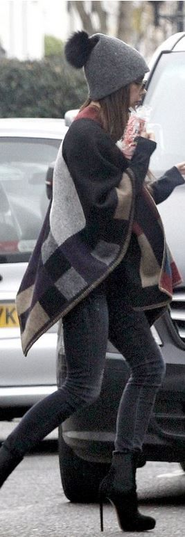 Who made  Victoria Beckham's plaid cape, gray skinny jeans, and black suede ankle boots?