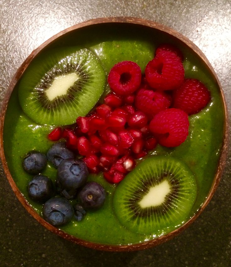 Green Smoothie Bowl #greensmoothie #smoothie #smoothiebowl #coconutbowl #smoothies  #pineapple  #mango #avocado #banana  #Spinach #water & #raspberrries #blueberries, #kiwi & #pomegranate on top #diet #nutrition #nutritionconsultant #healthyfood #eatplants #plantpower #plantfood #plantnutrition #plantnutrients #wholefoods #eatmoreplants