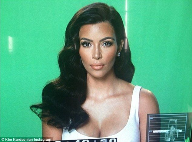 Glitz and glamour: Kim took to her social media site to share a snap from Saturday's publicising work, writing: 'Today's glam for interviews'