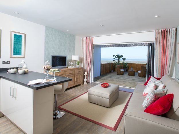 The Meldon Fields: Our beautiful open plan living room-dinner area with access to the balcony for stunning panoramic beach views. This is featured in Silver tides, Westward Ho! resort apartments.