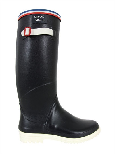 Maison Kitsuné x Aigle – Festival, womens hand made, marine blue Wellington boots, made using natural rubber drawn from tropical plantations. The boots feature a red, white and blue trim, buckled side adjusters for a more comfortable fit and a contrast white rubber sole.  Available at coggles.com