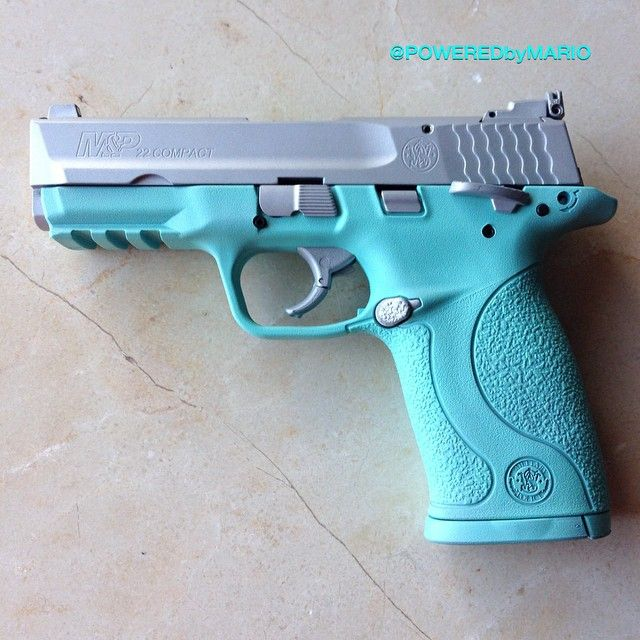 Smith & Wesson M&P 22 Compact cerakoted in Tiffany & Co blue and crushed silver.