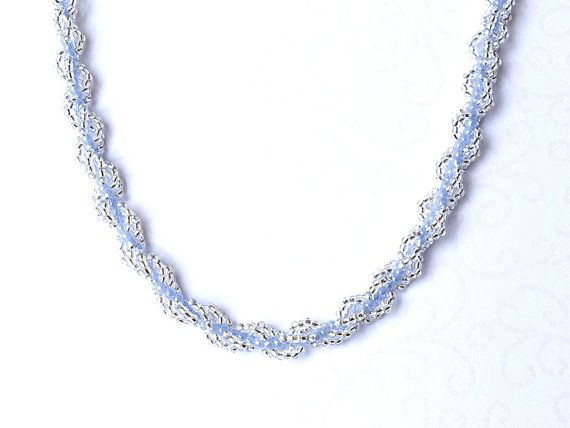 Beaded necklace with light blue and silver lined crystal seed