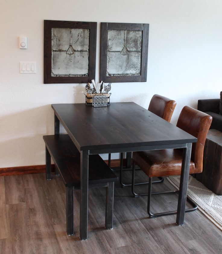 """Our """"Industrial"""" wood table with black metal legs. Sleek lines for a contemporary space."""