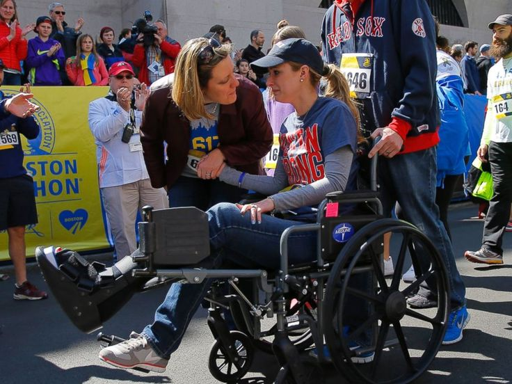 PHOTO: 2013 Boston Marathon bombing survivor Rebekah Gregory DiMartino crosses the marathon finish line during a Tribute Run for survivors and first responders in Boston on April 19, 2014.