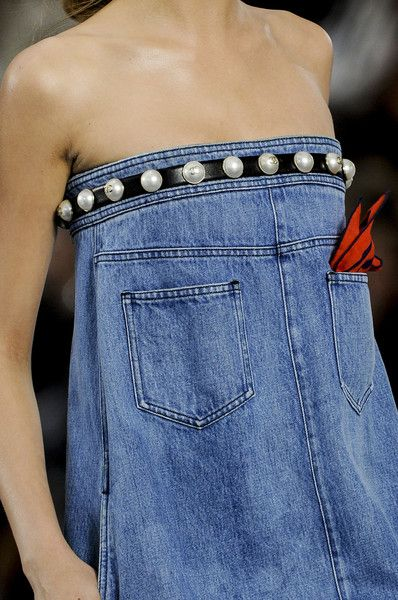 Bwahahahahahahah!!! Chanel Spring 2013 denim. The fact that she is so flat chested because of her lack of weight that it looks like scrawny man-butt in a dress is even funnier.