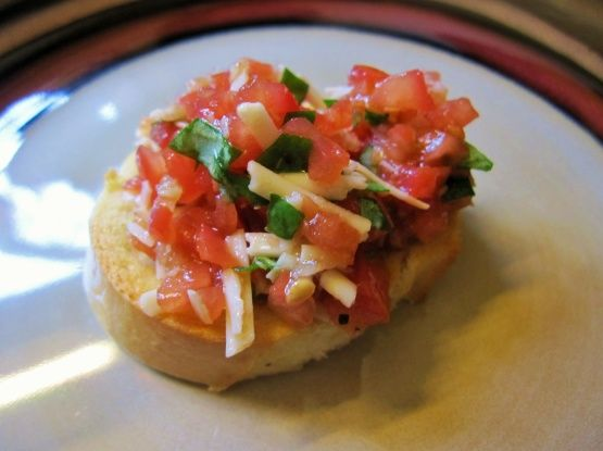 I went through a major bruschetta phase and tried many many recipes until I found the perfect one. This was originally Guy Fieris but is slightly adapted to my taste after making it about a billion times. Cookingt time is marinating time.