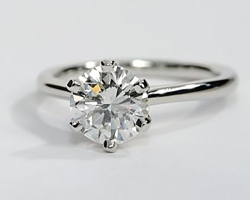 solitaire engagement ring with a thin band this