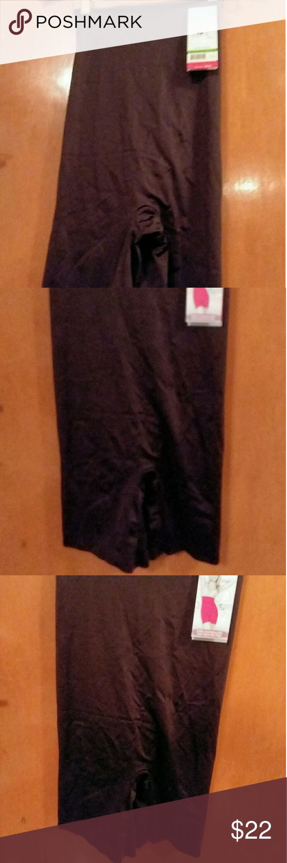 """Assets by Spanx High Waist Core Controller NWT L This is an Assets by Spanx black high waist mid-thigh core controller in size ladies Large. This item is New With Tags and originally retailed for $44. It is made of nylon and spandex with a cotton gusset. It is 22"""" long. This will slim the appearance of your middle for a streamlined look. Assets By Spanx Intimates & Sleepwear Shapewear"""