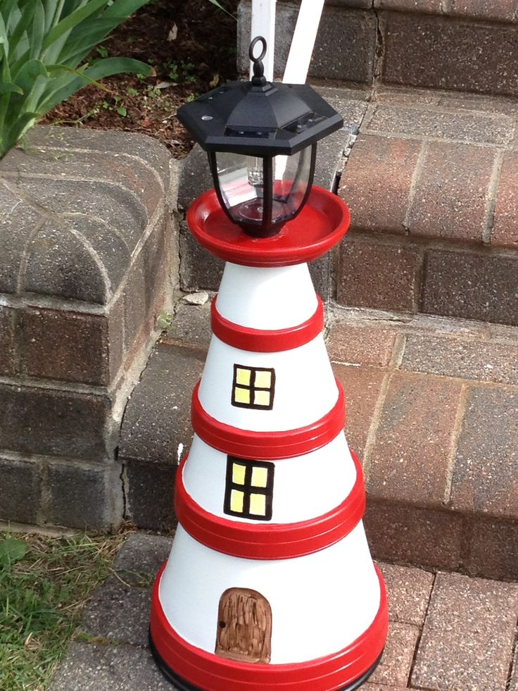 My second light house from clay pots. They are in the front of our house!