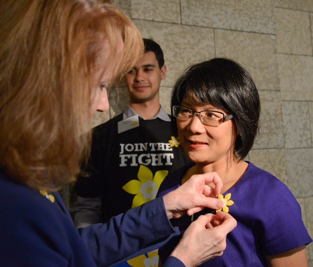 Our CEO Pamela Fralick pins Olivia Chow at Parliament Hill for DaffoHillDay. #mydaffodil