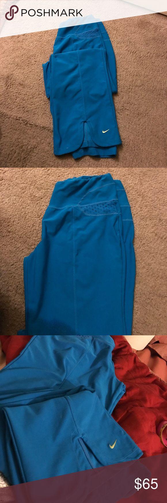 Nike Sea Blue Yoga pants Size Large excellent condition pants. Super comfy. Stretch Lycra legging material Nike Pants Track Pants & Joggers
