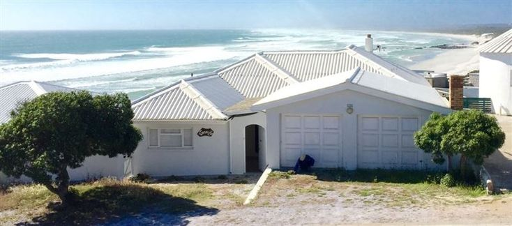 12 Main Road - 12 Main Road is situated in the small harbour town of Yzerfontein, along the Cape West Coast.  The house has four bedrooms and two bathrooms. There is a well-equipped kitchen, a lounge with DStv, and a ... #weekendgetaways #yzerfontein #southafrica