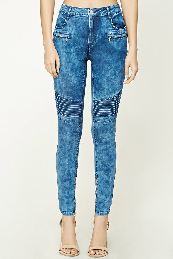 A pair of moto skinny jeans featuring ribbed panels, a faded wash, mid-rise fit, zippered ankles, front mock zippered pockets, a five-pocket construction, and a zip fly.