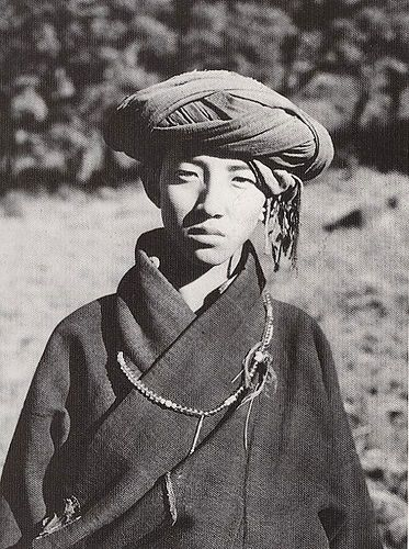 Yongning priest, 1928. A young Bonpo priest from Zuosuo, near Yongning, where the Bonpo school predominates - Joseph Rock.