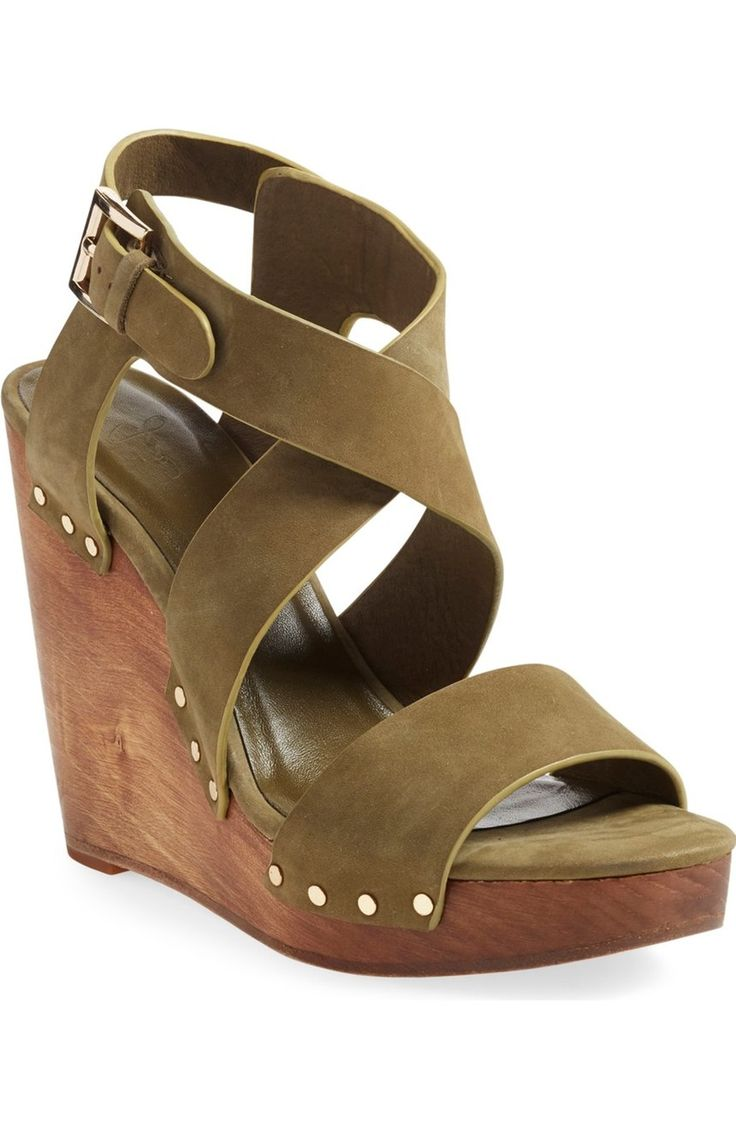 Swooning over this modern-meets-retro sandal with a rustic wooden platform wedge, olive green leather and antiqued nail-head rivets.