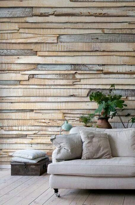 A reclaimed wood wall complements lighter colored furniture very well.