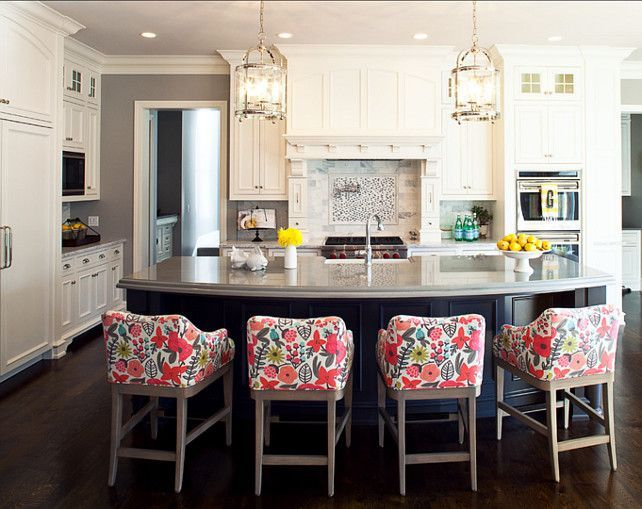 Love the light fixtures, dark island, and off white cabinets