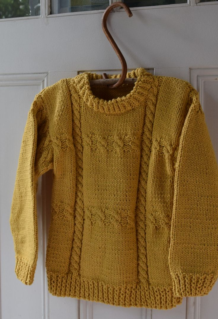 A classic pullover with cross cable design sized for 2-10 years.