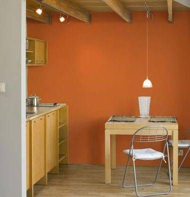 Orange for the common wall that stretches from the dining room through the living room