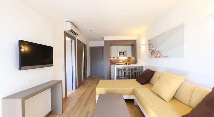 Apartamentos Jade Playa de Palma Located in a lively area of Palma, 150 metres from Palma Beach, these modern apartments are ideal for a sun-filled family holiday on the island.  Spend the day in the complex, soaking up the sun on one of the sun loungers surrounding the pool.