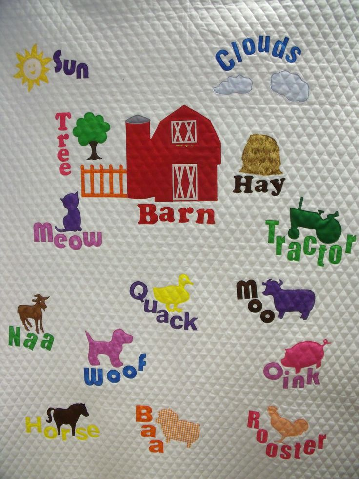 Barnyard quilt - a piece of pre-quilted fabric was used to make this baby/toddler quilt quick & easy.  A great way to use some of the animal appliques.  The barn, tractor, letters, etc. can all be purchased on the website www.appliquesquiltsandmore.com