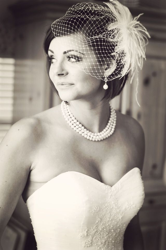 I like the birdcage veil that is cocked to the side and not covering her whole face