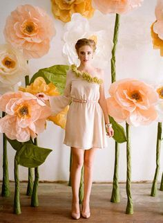 "Giant paper flower tutorial. Make up a ""garden-full"" and line the walls of the venue."