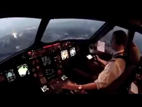 COCKPIT VIEW of plane landing.