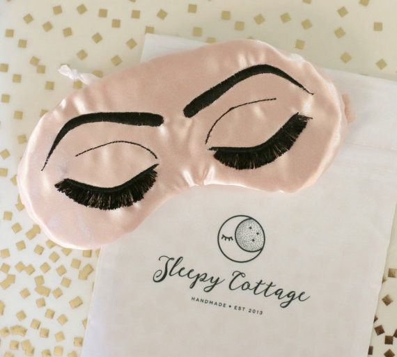 Take on the mean reds or sleep off last night's spontaneous soirée Holly Golightly style with this luxurious eye mask inspired by our favorite film, Breakfast at Tiffany's. Handcrafted with rich duche