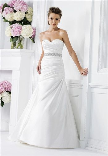 Ivory Double-Faced Satin ball gown with sheer scoop neckline.  Art deco beaded top with asymmetrical pleats at waist.
