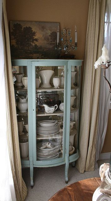 china cabinet shabby chic...I remember my sister having one of these filled with blown glass animals....and I thought it was crass!