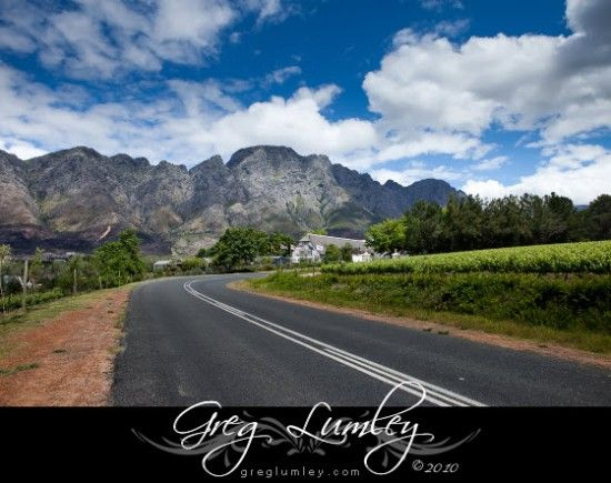 External view of Le Franschhoek Hotel with mountain in background
