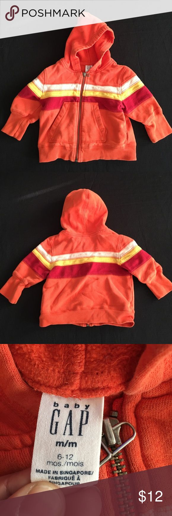 Baby Gap Orange Zip Up Hoodie 6-12 Months Baby Gap Orange Zip Up Hoodie. Has a front pockets. Orange with white, yellow and red stripes. 6-12 months. Gently used.  Bundle 221. GAP Shirts & Tops Sweatshirts & Hoodies