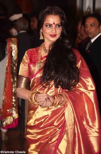 Rekha in a sunset hue kanjeevaram silk saree