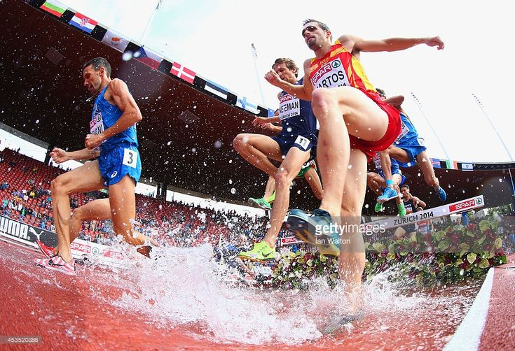 Sebastian Martos of Spain clears the water jump in the Men's 3000 metres Steeplechase heats during day one of the 22nd European Athletics Championships at Stadium Letzigrund on August 12, 2014 in Zurich, Switzerland.
