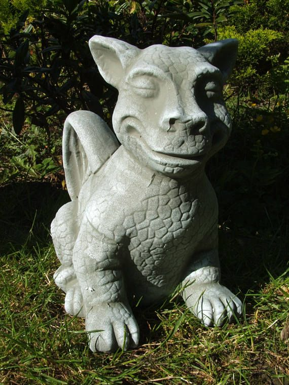 THIS IS A BRAND NEW MOULD TO MAKE A CHEEKY SITTING DRAGON. MEASURES 30 CMS TALL.   YOU CAN USE SAND AND CEMENT MIXTURE, PLASTER OF PARIS OR MOULDING POWDER  ALL MOULDS COME WITH EASY TO FOLLOW INSTRUCTIONS