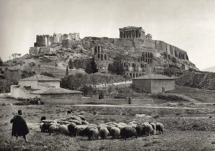 Man herding his sheep in the shadow of the Acropolis, early 1900s. This photograph was taken by the Swiss photographer Fred Boissonas. Mister Boissonas is known for his incredible photographs of ancient Greece and it's beautiful nature. The Acropolis of Athens is an ancient citadel located on a high rocky outcrop above the city of Athens and containing the remains of several ancient buildings of great architectural and historic significance.